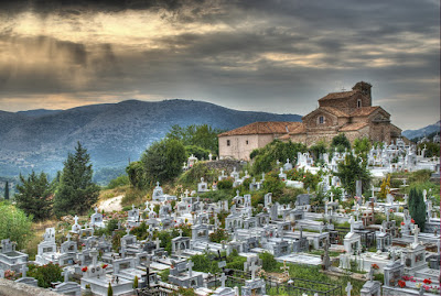 cemetery-1600Cemetery with the sun peeking thru in Paramythia, Greece