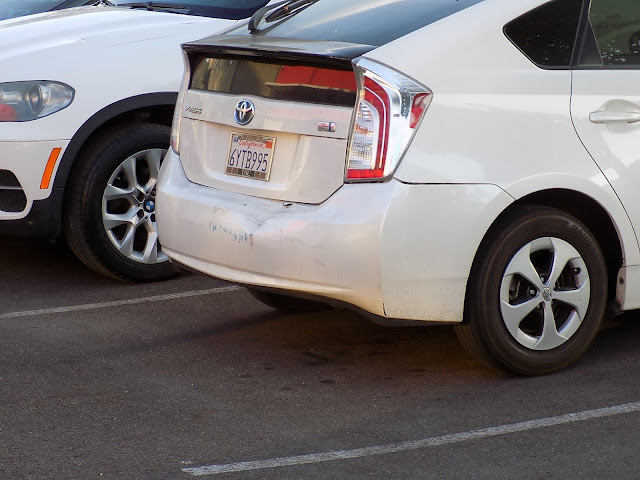 Rear bumper and tailgate damage before repairs at Almost Everything Auto Body.