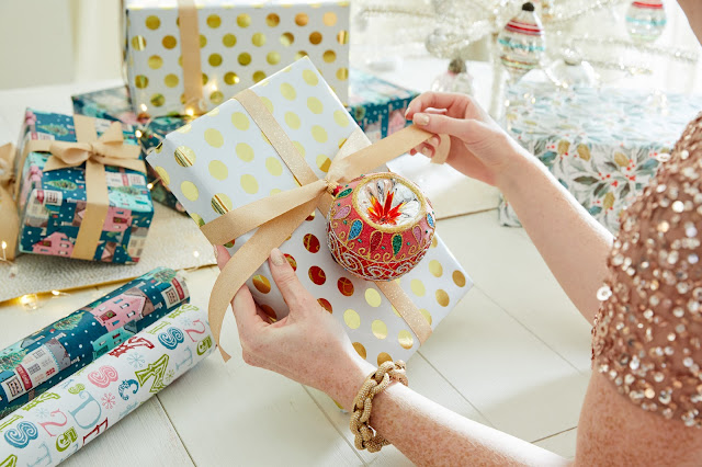 Using ornaments as gift wrap decor