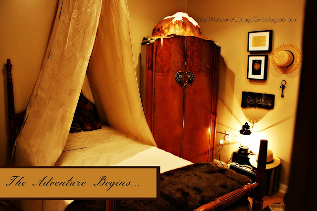 photo of a bedroom with a twin bed with canvas tent over it, wooden wardrobe with a volcano on top, lantern light | Adventure Room, Adventure Bedroom, archaeology, Indiana Jones room, by Rosevine Cottage Girls