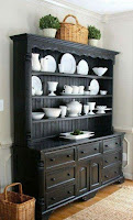 Black dining room hutch with display panels