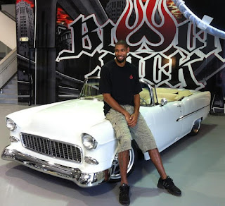 Amy Sherrill's ex-husband Tim Duncan posing for photo with a classic car