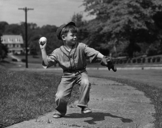 A young boy pitching c.1930 Go Home, marchmatron.com