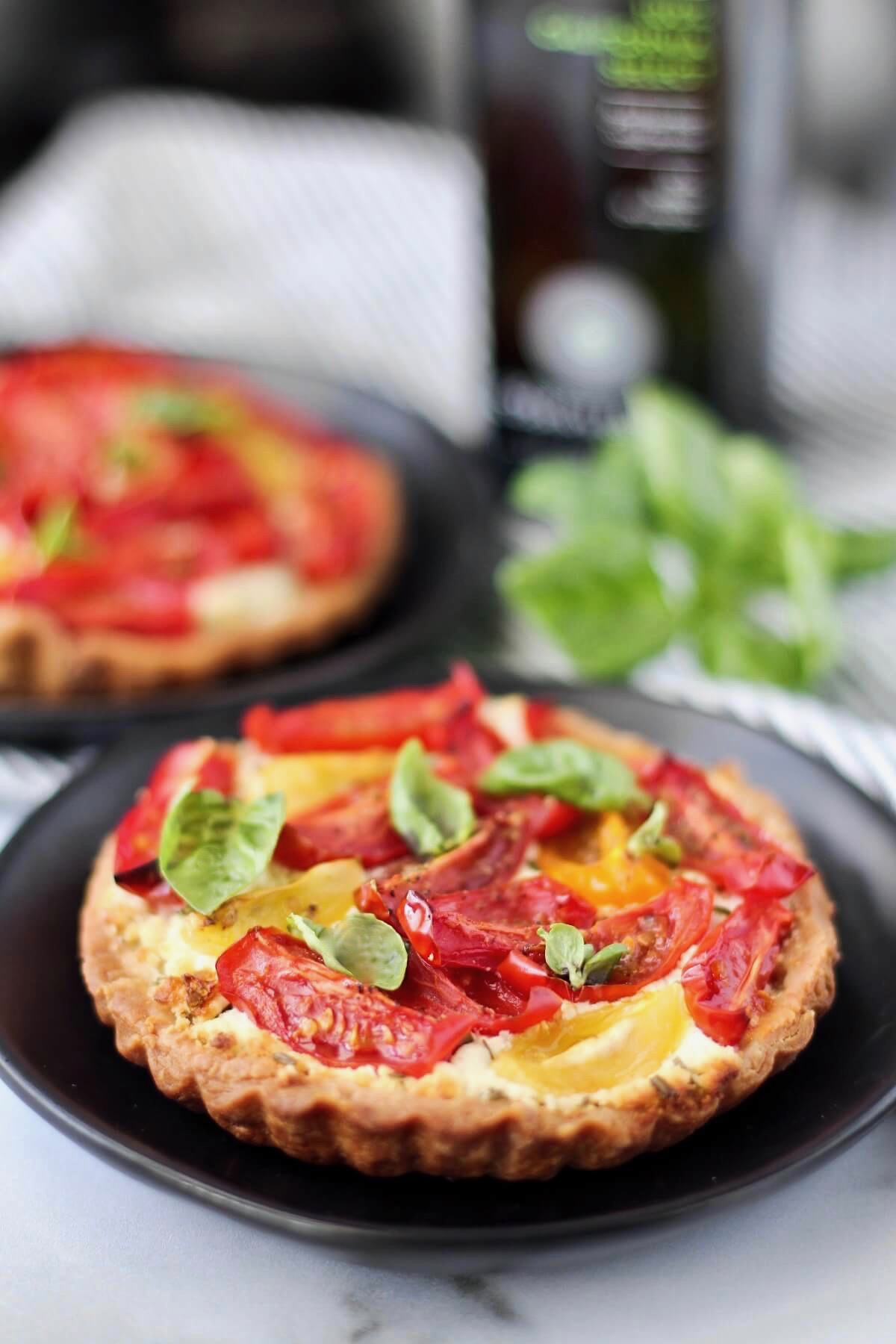 Tomato and Goat Cheese Tarts on plates.