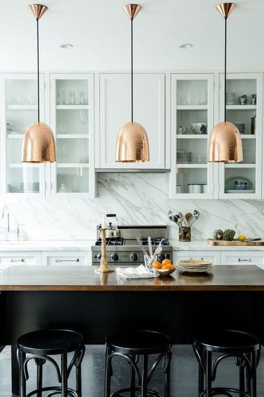 design-trends-warm-metals-copper-lights white kitchen