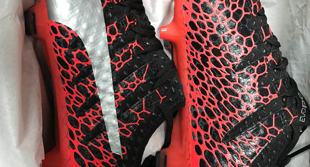 black and red puma football boots