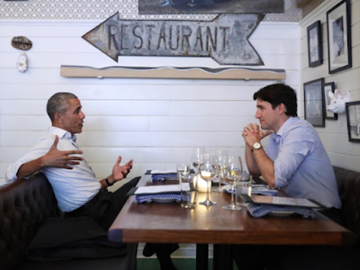 q - Barack Obama pictured enjoying a meal with Prime Minister, Justin Trudeau in Montreal