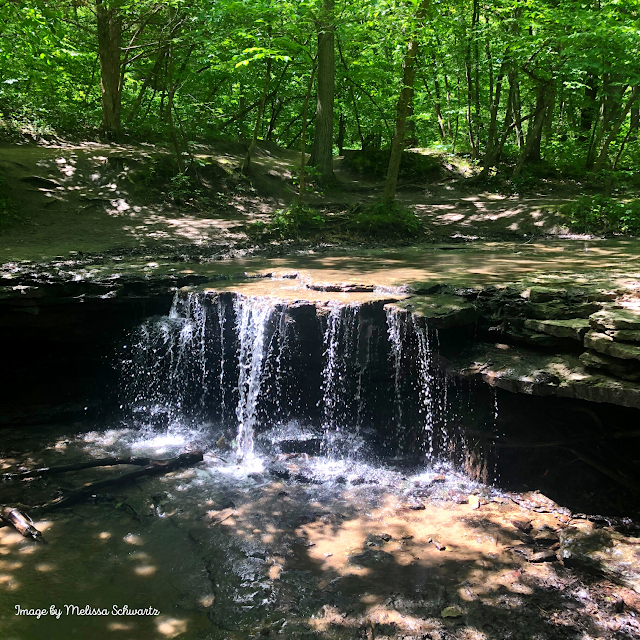 The gentle trickle of the waterfall at Platte River State Park crafts a moment of serenity.