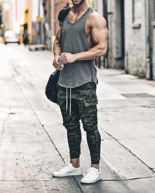 Man wearing Wife beater and joggers.