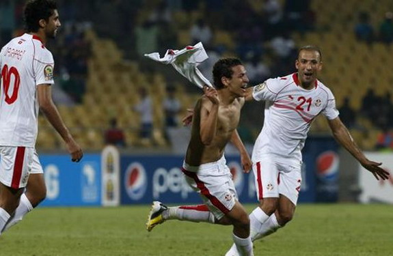 Tunisian player Youssef Msakni celebrates after scoring a late winner against Algeria