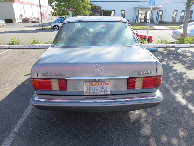 a nameplate was missing on the trunk of this Mercedes before getting repainted.