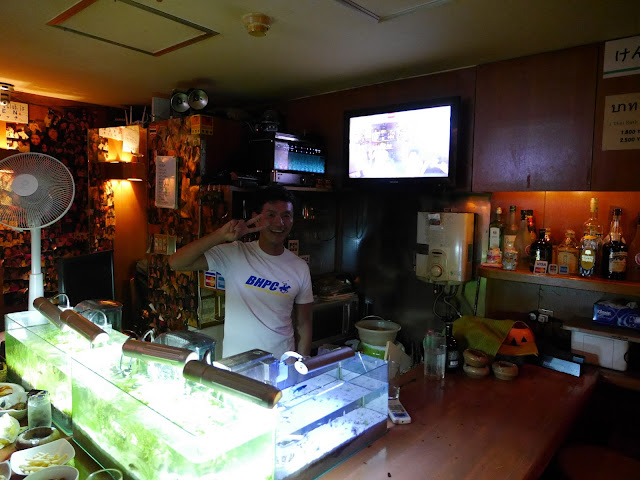 The bar at Ken's Club gay bar, complete with fish tanks,.
