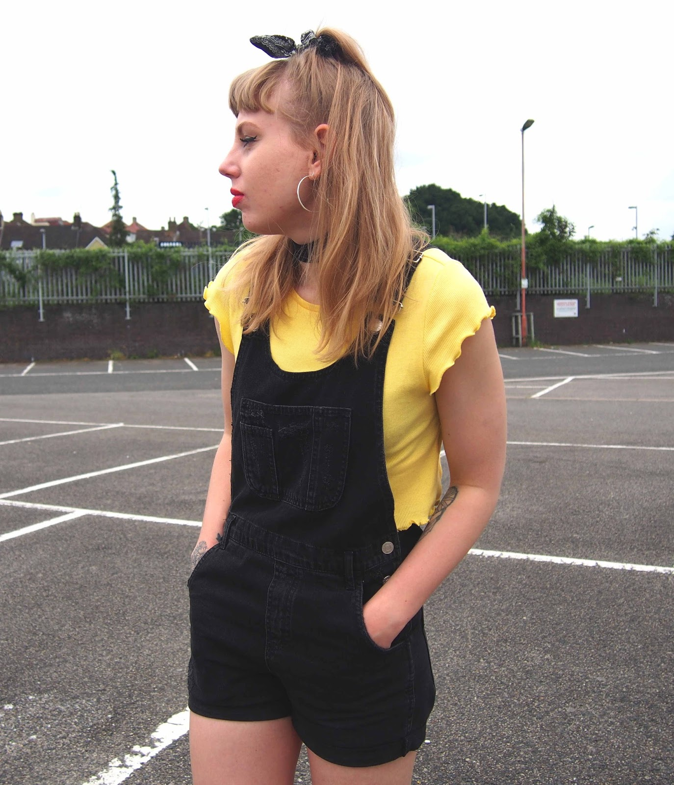 how to style black denim dungarees, yellow ribbed frilly trim top, 90's fashion style, 90's grunge outfit, spring summer alternative unique ootd, wide choker, dr martens 1