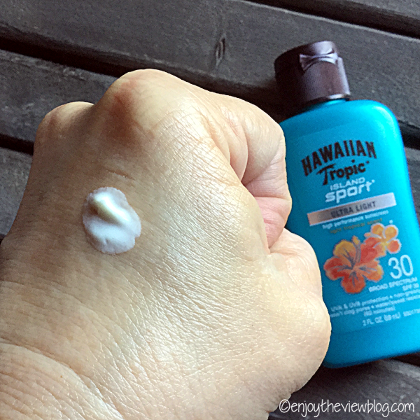Sample of Hawaiian Tropic Island Sport Ultra-Light Sunscreen SPF 30 spread out a little on the back of a hand