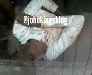 A dead man in police car