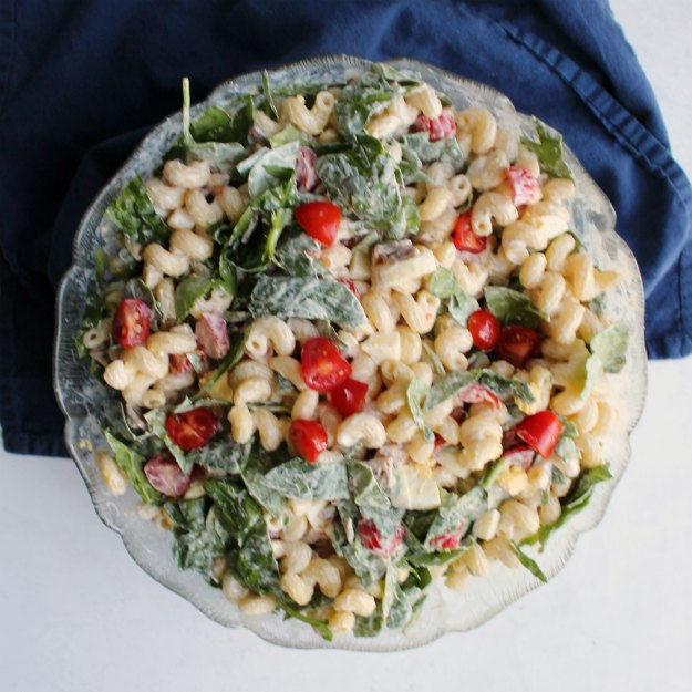 big glass serving bowl filled with blt pasta salad