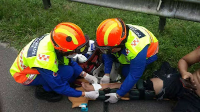 Participants helping a victim of an accident at Bukit Jalil.