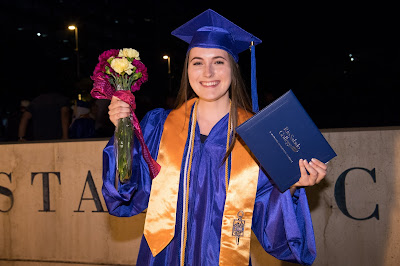 image of rio salado student smiling with flowers and diploma