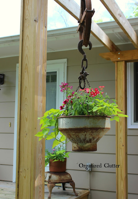 Photo of a junky planter with pulleys.
