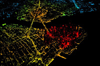 "Nighttime image of New York City, with the red showing a large population density. ""The adoption potential of electric vehicles is remarkably similar across cities, from dense urban areas like New York, to sprawling cities like Houston. This goes against the view that electric vehicles — at least affordable ones, which have limited range — only really work in dense urban centers,"" says Jessika Trancik, the Atlantic Richfield Career Development Associate Professor in Energy Studies at MIT's Institute for Data, Systems, and Society (IDSS). (Image Credit: Flickr user Doc Searles/CC by 2.0 (edited by the researchers)] Click to Enlarge."