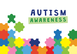 Illustration of colourful jigsaw pieces and text reading Autism Awareness