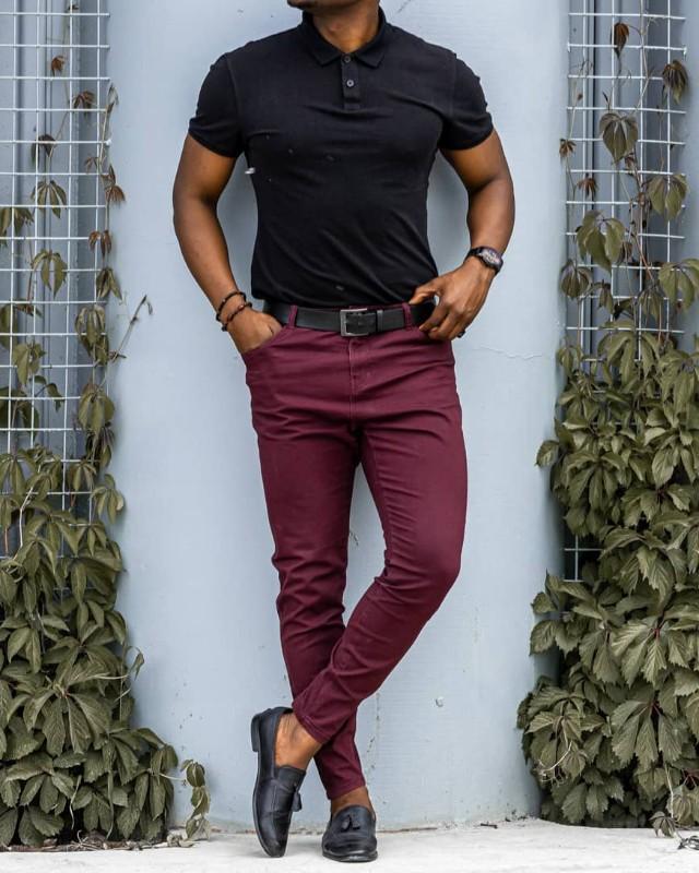 Black polo shirts and maroon chinos, men.