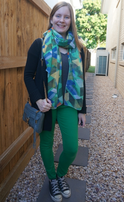 matching colourful green printed scarf with green skinny jeans, neutral layers and blue bag | away from the blue