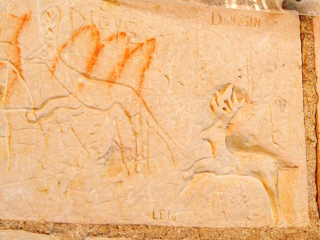 Leaping stag graffiti in the Louis XII tower of the medieval chateau of Loches.  Indre et Loire, France. Photographed by Susan Walter. Tour the Loire Valley with a classic car and a private guide.