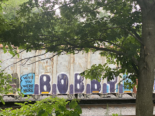 """""""Wish You Were Here  B.O.B.B.Y"""" Spray-painted on the side of a freight train car (pictured somewhere in Queens, New York"""