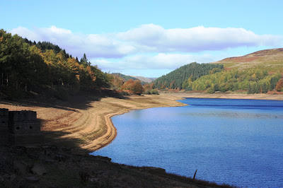 Photo of the reservoir showing some water but lots of bank too.