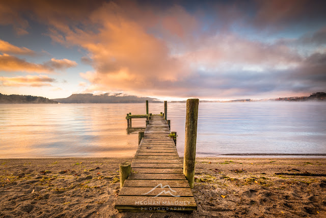 colourful sunrise lake tarawera jetty