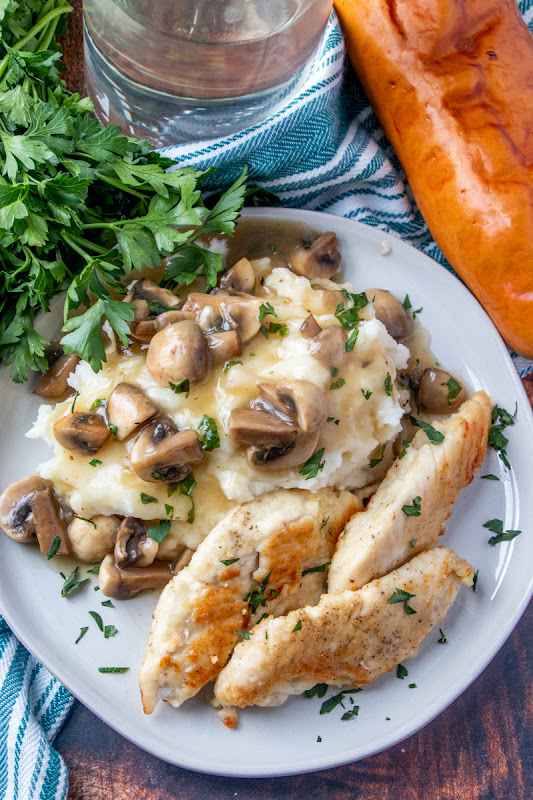 This easy meat and potatoes comfort food meal is perfect for a weeknight dinner, or even Sunday dinner! The mushrooms are delicious in the gravy with the chicken and you can serve with mashed potatoes, rice or pasta! Such a great homemade recipe!