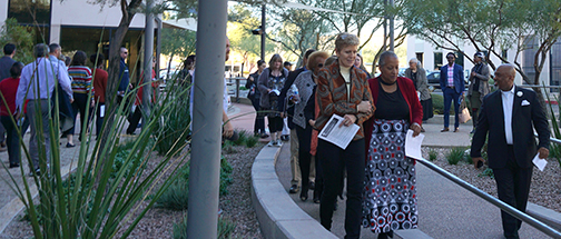 Pam Tucker and Wanda Tucker lead march around Rio Salado College