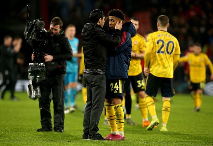 Arsenal head coach Mikel Arteta and midfielder Reiss Nelson
