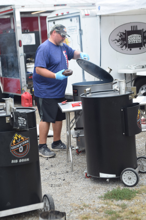 Cooking on drum smokers at the 2019 Praise The Lard BBQ Contest