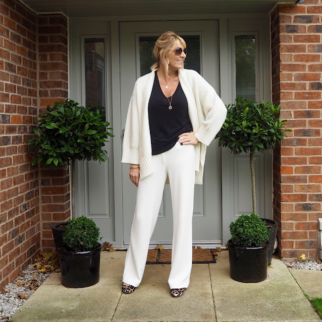 winter white trousers and black top