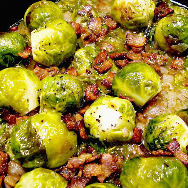 This Brussels Sprouts with Bacon and Shallots recipe is a crowd-pleasing, holiday-ready version of a classic combo of brussels sprouts and bacon. Low carb, gluten-free, and keto-friendly, we love this dish for a regular weeknight as well. #keto #lowcarb #brusselssprouts #bacon #onion #shallot #thanksgiving #christmas #sidedish #recipe | bobbiskozykitchen.com
