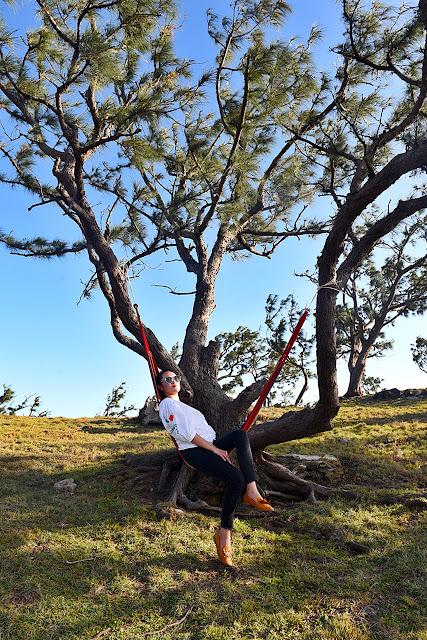 TPB's Genesis Lee relaxes on a hammock in Nagudungan Hill in Calayan Island