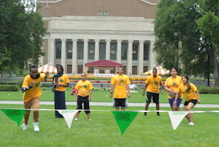 Group of 4-H youth running on the mall of the University of Minnesota campus