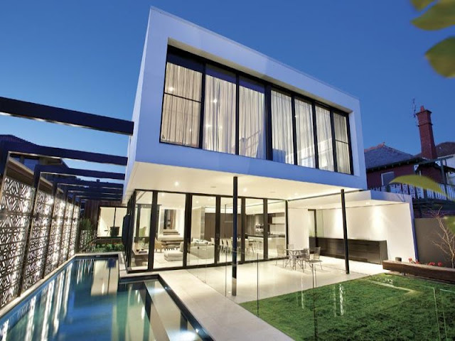 Photo of amazing modern home as seen at sunset from the pool area