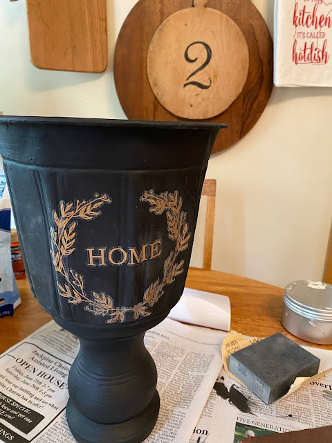 Photo of a black urn with a gold decor transfer