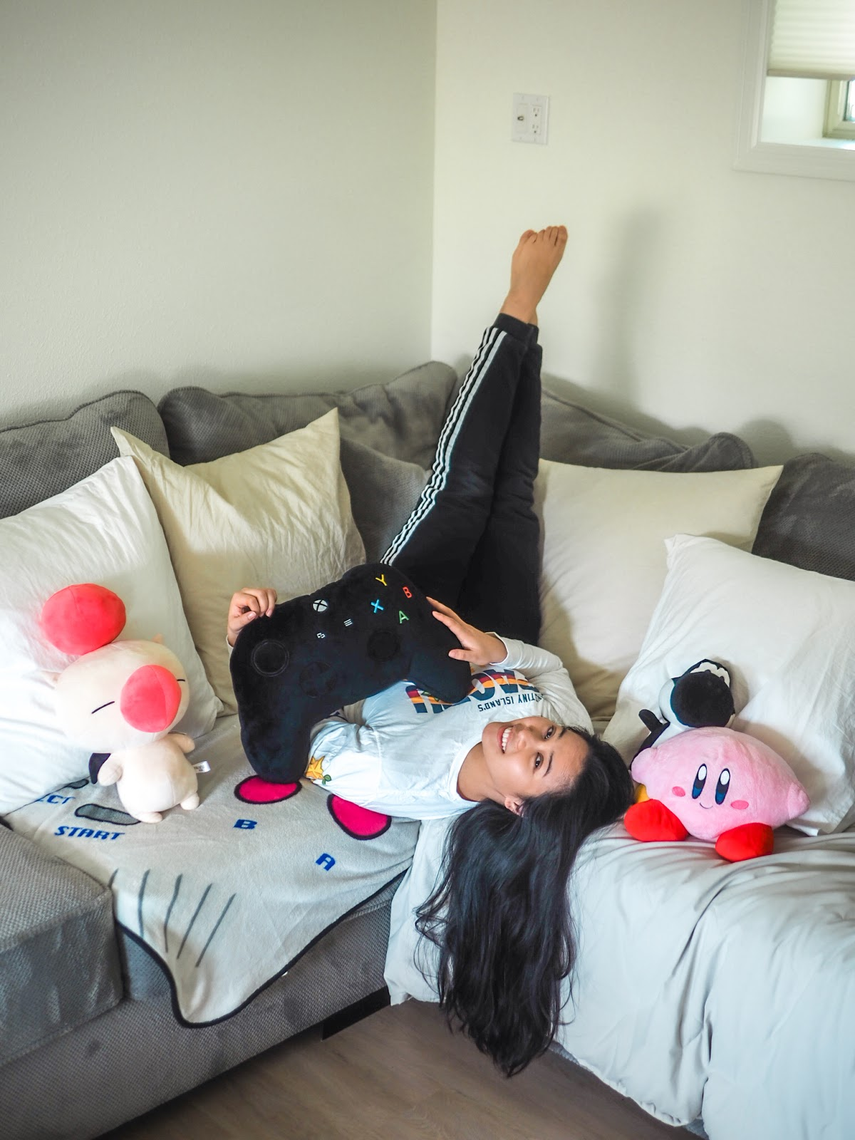 Kirstie chan seattle blogger upside down on couch with gaming pillows xbox moogle kirby