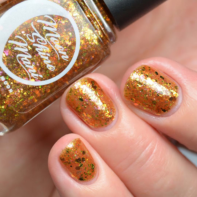 gold glitter nail polish swatch