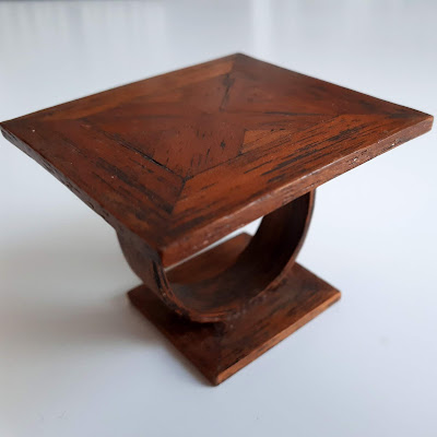 1/12 scale miniature oak coffee table with inlaid top and curved botttom.