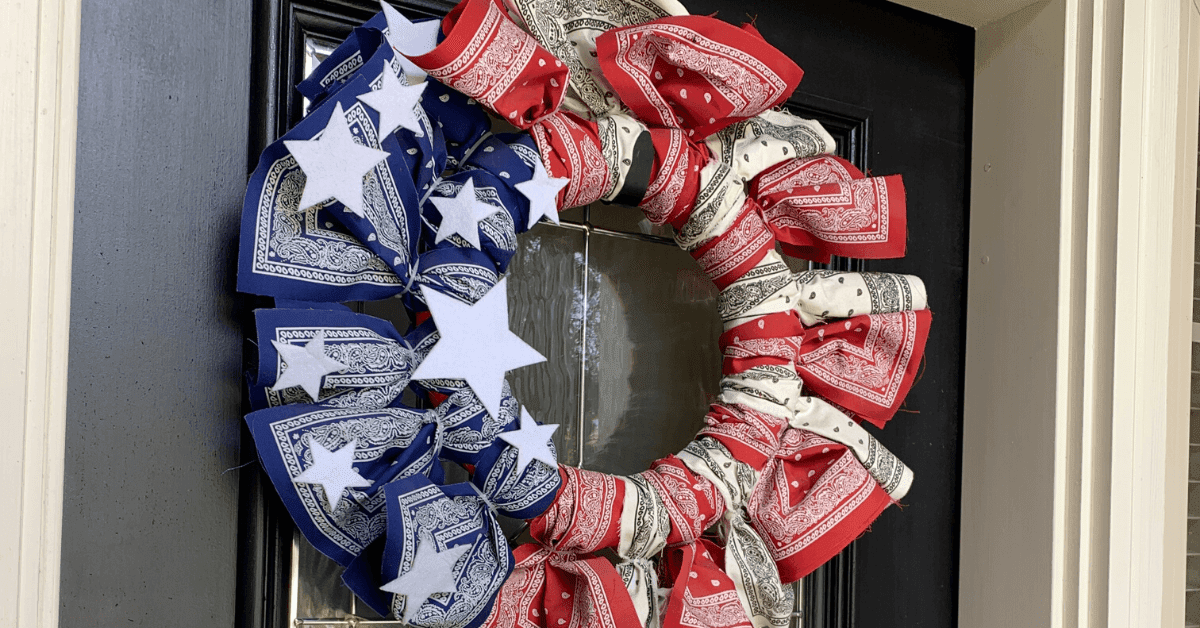 Red, white, and blue bandanna wreath on a black door
