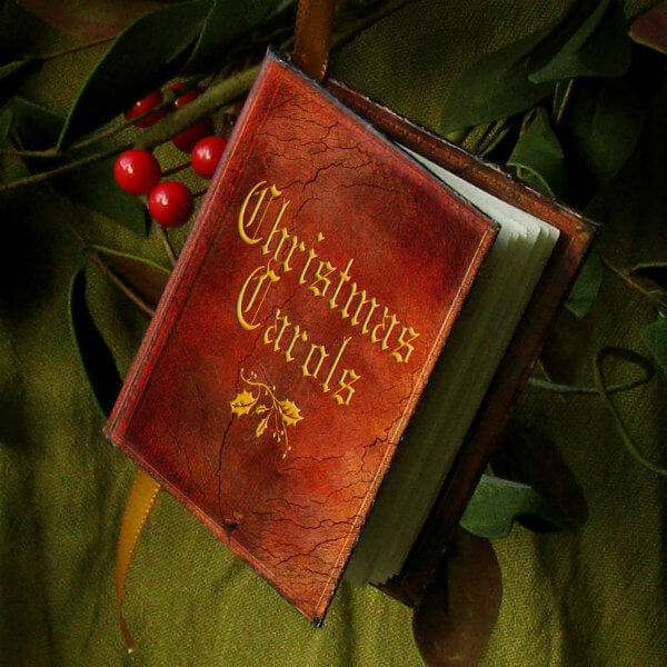 miniature handmade book of Christmas carols ornament with rustic leather-like cover