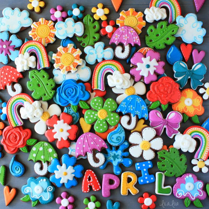 Spring flower and rainbow decorated chocolate sugar cookies