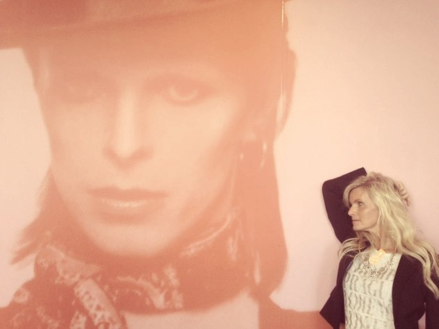 posing with giant David Bowie photograph at mca chicago by Hello Lovely Studio