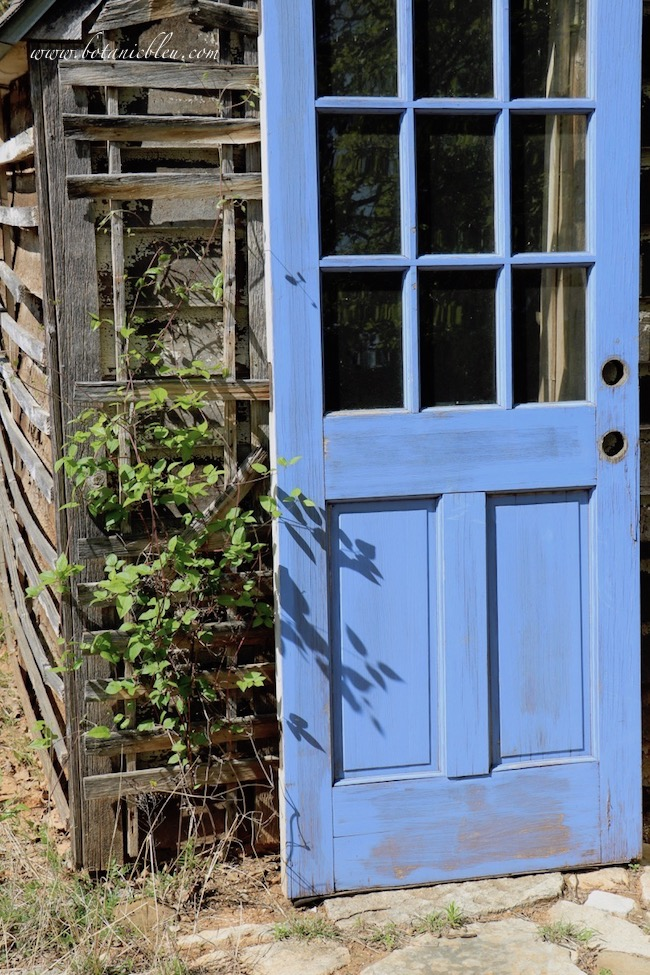 Well House to Tool Shed Plans call for replacing old wooden blue door with new door
