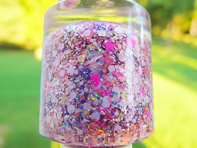 BING BONG- a clear based filled with hot pink hearts, hot pink stars, pink dots in many different sizes, holo silver glitter, light pink shreds, light purple shreds, light yellow shreds, light pink spades, tons of micro hex pink glitters.